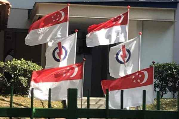 Disgusting PAP flag beside Singapore's flag in Hougang during National Day