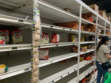 Minister Chan urges calm as essentials fly off supermarket shelves